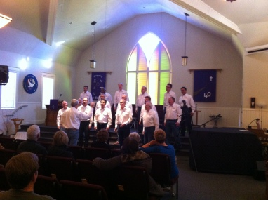 The Men's Chorus, made up on the spot from most of the men attending!
